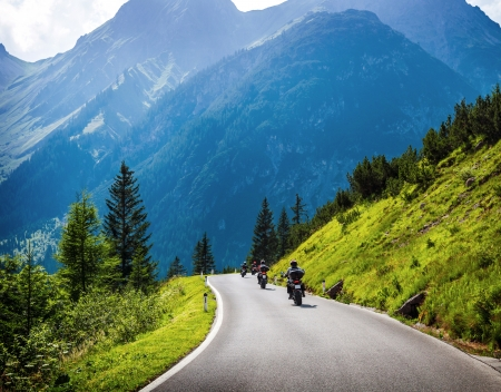 Photo pour Moto racers riding on mountainous road, drive a motorcycle, summer adventure, extreme sport, travel to Europe, active lifestyle, vacation concept  - image libre de droit