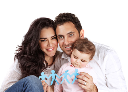 Young arabic family isolated on white background, holding in hands bonding paper people figure, safety and security, human reproduction concept