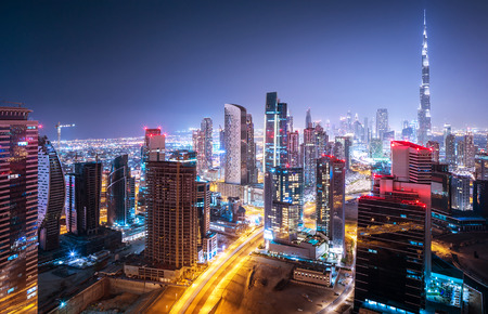 Beautiful night cityscape of Dubai, United Arab Emirates, modern futuristic arabian architecture with many little lights in the nighttime, luxury traveling concept