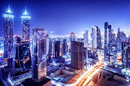 Dubai downtown night scene, UAE, beautiful modern buildings, bright glowing lights, luxurious travel and tourism