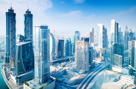 Beautiful Dubai city, bird eye view on majestic cityscape with modern new buildings, daytime panoramic scene, United Arab Emirates