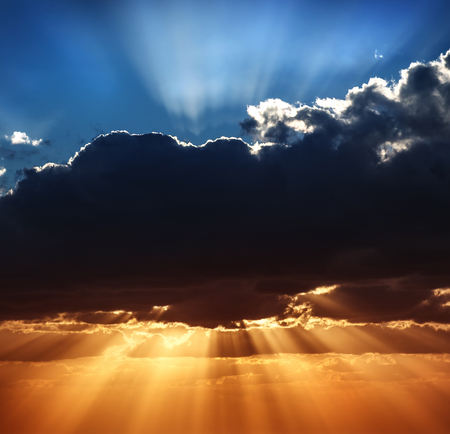Photo pour Beautiful heaven landscape, blue and yellow sky, amazing view on sun rays breaking through big dark clouds, beauty of wonderful nature - image libre de droit