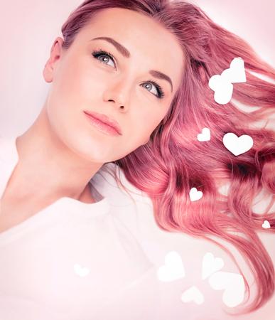 Photo pour Woman fashion portrait, hair idea for Valentine's day, stylish pastel pink hair color, trendy wavy long hairstyle, beautiful model with romantic look - image libre de droit