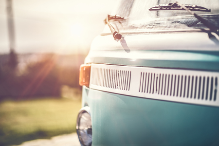 Rare vintage camper van, renovated car of 70's, nice old vintage blue bus, happy travel in exclusive car on bright sunny day
