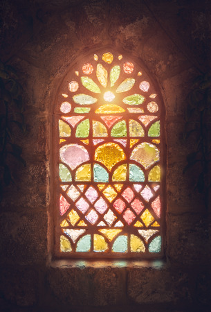 Foto de Stained glass window, amazing colorful window of an ancient church, house of god, place of worship, old ancient cathedral of Lebanon - Imagen libre de derechos