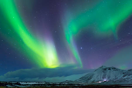 Photo pour Beautiful view on Aurora Borealis, the amazing northern light in the night sky, wonderful nature of Iceland - image libre de droit