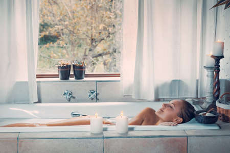 Photo pour Happy woman at spa resort, nice female with closed eyes of pleasure taking bath, beauty and health treatment, spending vacation at wellness hotel - image libre de droit