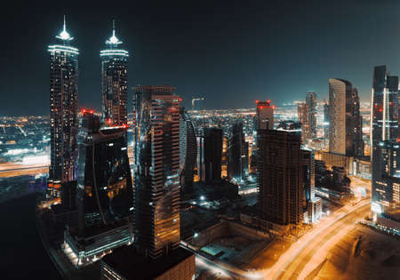 Foto de Beautiful Cityscape of a Modern Futuristic Buildings and Towers in the Lights of a Night City. Beauty of Luxury Life of Emirates. Dubai. United Arab Emirates. - Imagen libre de derechos