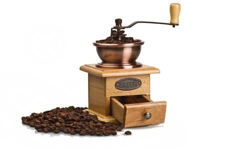 Vintage hand coffee grinder on white