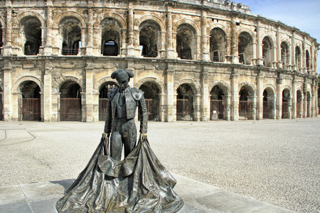 Roman Coliseum with a statue of a bullfighter- Nimes, France