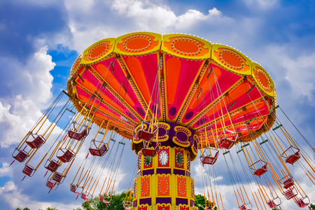 Photo for Colorful swing ride at the amusement park - Royalty Free Image