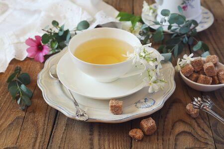 Photo pour Decorative composition of vintage style: romantic tea drinking with jasmine tea. Toned image - image libre de droit