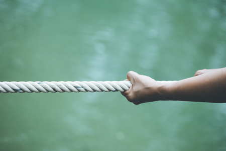 Photo for hands pulling on a rope  Concept of being alone Strengthened - Royalty Free Image