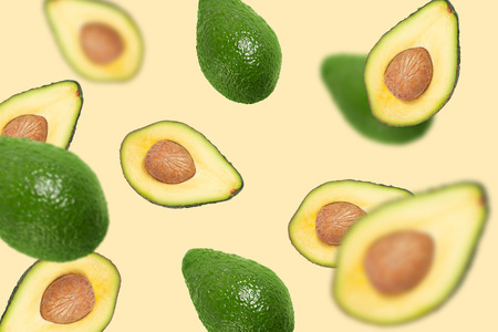 Photo pour Flying avocado. Abstract flying fruits, half sliced with a bone inside - image libre de droit
