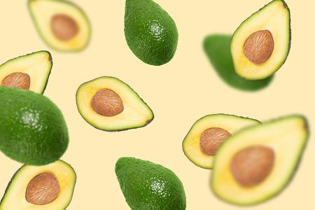 Foto de Flying avocado. Abstract flying fruits, half sliced with a bone inside - Imagen libre de derechos