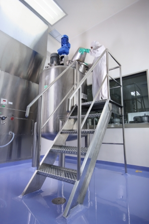 Specialized workers at pharmaceutical manufacturing facility