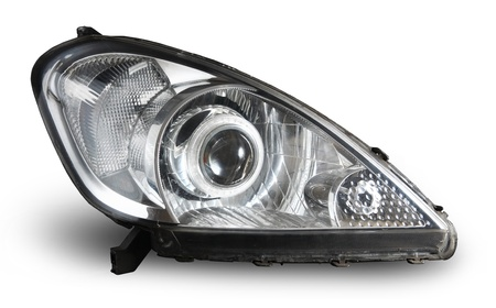 Modern car projector headlight isolated on white