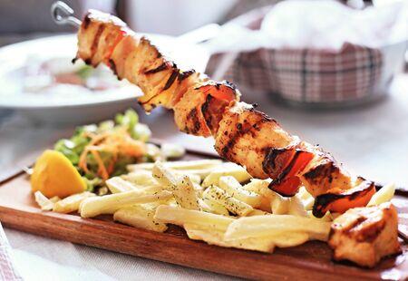 Photo for traditional greek souvlaki with chicken and potatoes - greek kontosouvli - greek cuisine - Royalty Free Image