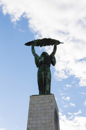 Statue in Budapest, Hungary on blue sky background