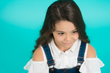 Hairstyle kid model on blue background. Hairstyle, hair style, hairstyling, style, hairdressing, beauty salon concept