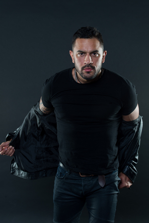 Man in tshirt undress leather jacket. Bearded man with serious face. Fashion macho in casual style clothes. Confidence and charisma. Fashion style and trend concept