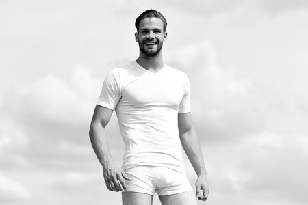 Health and fitness concept. Macho wearing white tshirt and underwear. Male body with sexy torso wearing white tshirt and underwear