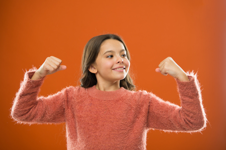 Photo pour Child cute girl show biceps gesture of power and strength. - image libre de droit