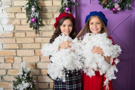 Photo for Warm winter wishes. Happy children celebrate Christmas and new year. Small children with artificial snow. Small girls with Christmas decoration. Winter fun. Childhood games on winter holidays. - Royalty Free Image