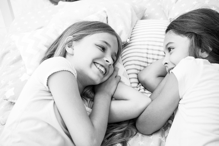 Photo pour Best friends forever. Girls relaxing on bed. Slumber party concept. Girls just want to have fun. Invite friend for sleepover. Consider theme slumber party. Slumber party timeless childhood tradition. - image libre de droit
