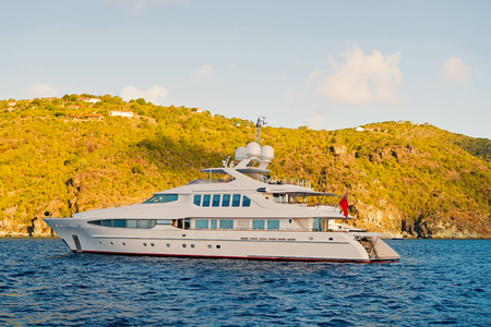 Photo pour Yachting and sailing adventure in gustavia, st.barts. Yacht at sea coast on sunny blue sky. Luxury travel and voyage on boat. Summer vacation on tropical island. Water transport and marine vessel. - image libre de droit