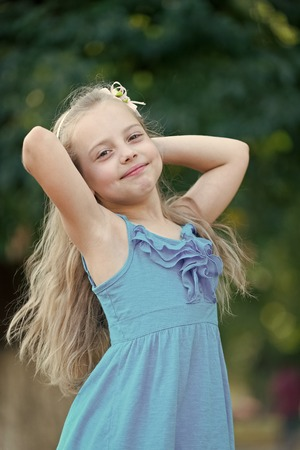 Photo pour Child smile with long blond hair, hairstyle. Child, childhood, innocence youth concept - image libre de droit