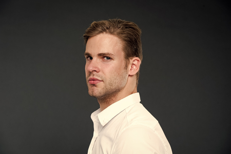 Foto de Confidence and masculinity. Guy confident in his appearance. Man well groomed with bristle and hairstyle dark background. Macho confident strict face close up. Guy handsome attractive white shirt. - Imagen libre de derechos