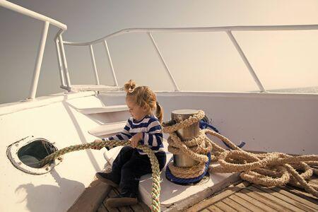 Foto de Journey concept. Little kid enjoy sea journey. Get ready for journey. - Imagen libre de derechos