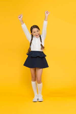 Photo for Back to school. Student little kid adores school. Emotional schoolgirl. Celebrate knowledge day. September time to study. Girl adorable pupil on yellow background. School uniform and fashion. - Royalty Free Image