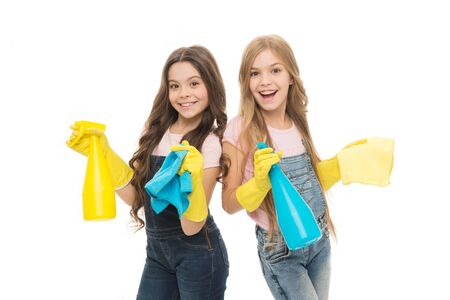 Photo for Dirt is not welcome in our home. Adorable little girls wearing household rubber gloves. Small children holding household spray bottles. Enjoying household activities. Providing household help - Royalty Free Image