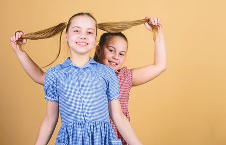 Photo pour Happy children play together. Having sister is always fun. Best friends forever. Happy childhood. Girls sisters having fun together. Adorable sisters smiling faces. Family love. Sisterhood concept - image libre de droit