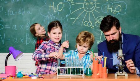 Photo for Little kids learning chemistry in school laboratory. school kids scientist studying science. happy children teacher. back to school. students doing science experiments with microscope in lab - Royalty Free Image