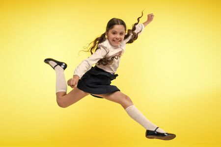 Photo for Toward knowledge. Girl make supernatural efforts on way to knowledge. Thirst of knowledge. Back to school. Kid cheerful schoolgirl full of energy jump in mid air. Pupil want study. Lets begin study - Royalty Free Image