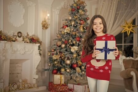 little child girl likes xmas present. Happy new year. small happy girl at christmas. Christmas. Are you ready. Kid enjoy the holiday. The morning before Xmas. New year holiday. my present