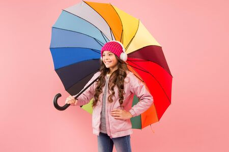Entertain yourself. Fun concept. Feeling good. Girl having fun walking wireless headphones under colorful umbrella. Fall leisure. Music always with me. Every day fun. Child enjoying simple things