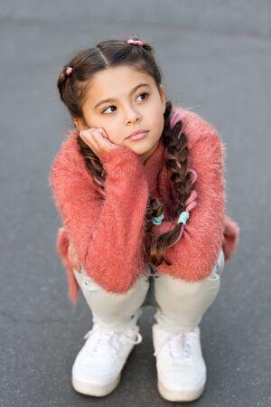 Autumn depression. Girl little kid sad face dislike something. Kid unhappy small baby. Reasons why kids dislike. Sadness concept. Kid in seasonal depression. Depression and emotional problems