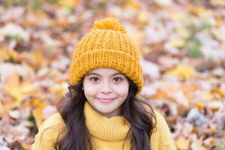 Foto de Accessory to protect your head. Adorable small child wear knitted accessory. Cute little girl with fashion accessory. Looking trendy in stylish accessory. Kids hats for autumn season - Imagen libre de derechos