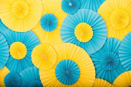 Foto de Round decor texture. Party shop concept. Round blue and yellow decorative details. Decorate. Buy decorations. Ukrainian colors. Festive decor. Birthday and holidays decor - Imagen libre de derechos