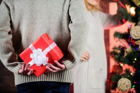 Prepare surprise. Winter surprise. Man carry gift box behind back defocused background. Christmas surprise concept. Surprising his wife. Giving and sharing. Surprise effect. Generosity and kindness