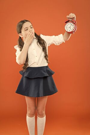 Photo for Developing discipline. Time for break and relax. Vacation time. Elementary school day bell schedule. Schooltime concept. Schoolgirl child formal uniform hold alarm clock. Time to study. Classes begin - Royalty Free Image