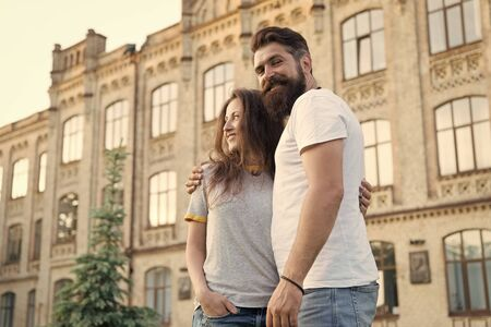 Photo pour Happy together. Couple in love walking having fun. Tender hug. Couple relaxing enjoying each other. Hipster and pretty woman in love stand in street architecture building background. Feel my love - image libre de droit