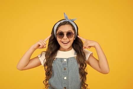 Foto de UV protection. Girl long curly hair sunglasses tied head scarf. Fashion trend. You can have anything you want if dress for it. Little fashionista. Cute kid fashion girl. Summer fashion concept - Imagen libre de derechos
