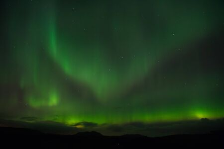 Photo pour Nature miracles. Aurora dark sky. Amazing nature phenomena. Best place see aurora borealis. When is best time to see northern lights. Place to see northern lights. Northern light black sky with stars. - image libre de droit