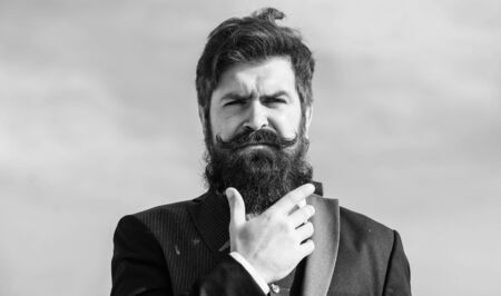 Photo for Bearded man. Future success. Male formal fashion. brutal caucasian hipster with moustache. Businessman against the sky. Mature hipster with beard. Bearded man touch beard. Man with beard outdoor - Royalty Free Image