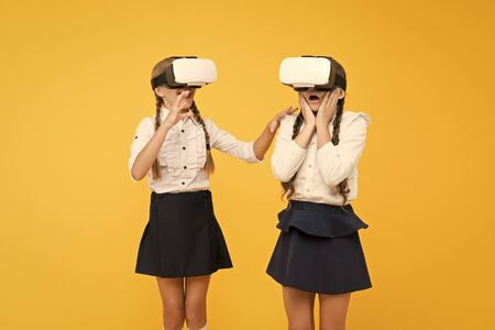 VR headset. Future education. Children schoolgirls wear wireless VR glasses. Exploring augmented reality. Experiences communicate and manage projects.Kids use modern VR technology. Virtual reality.